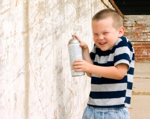 Kid Whitewashing a Wall