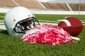 Football helmet and cheer pompoms