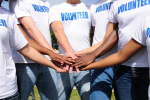 volunteers with hands together